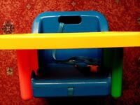 Safety 1st toddler dining seat. Sturdy plastic and comes apart for easy cleaning.