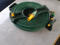 green flat hose on reel with fittings