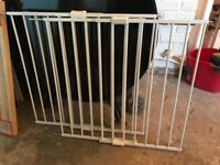 Two metal safety stair gates