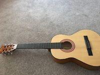 Guitar , in relatively good condition has few marks on front , needs tuning