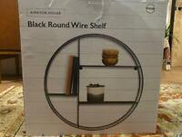 Black industrial metal wire round shelf