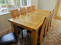 Solid oak extending dining table and 10 chairs