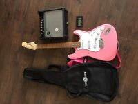 Pink electric guitar,case,amp and tuner