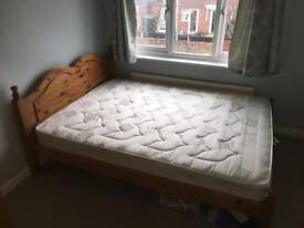 King sized pine bed with mattress in good condition.