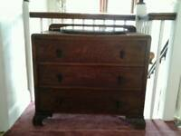 Chest of drawers with oval mirror