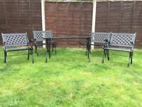 Ornate Cast Iron Garden Table and four Chairs