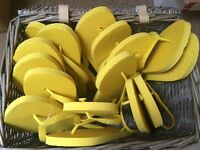 8 pairs of yellow flip flops