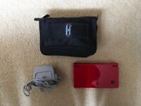 Red Nintendo DSi with 'Switch n Carry' case, Charger and a range of Games in its original packaging