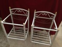 pair of white wrought iron bedside tables with glass shelf