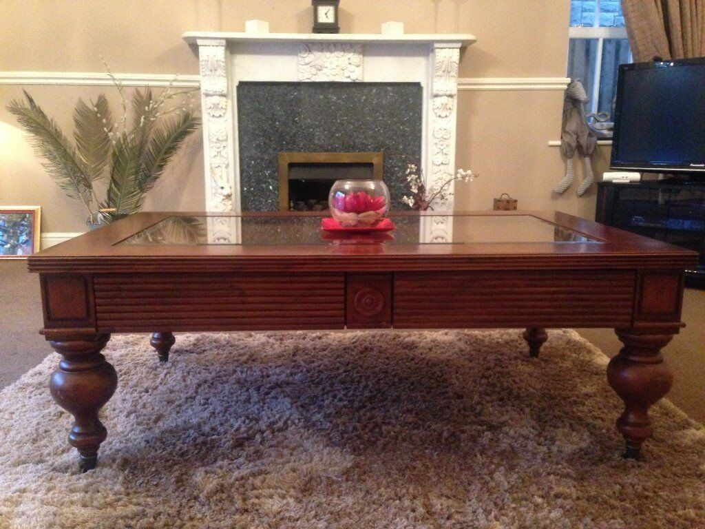 Colonial Style Coffee Table In Dark Cherry Wood With Gl Middle Showing Rattan Underneath