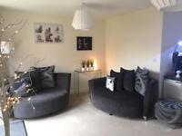 2x 2 seater cuddle sofas AS NEW in Charcoal grey