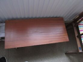 wood table with legs and castors in great condition