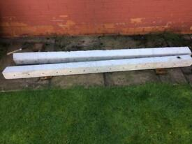 Two concrete fence posts