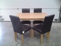 Ex display table and 4 choc brown chairs. Can deliver.