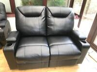Electric reclining faux leather sofa