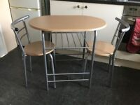 small compact table and 2 chairs