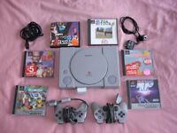 Sony PS1 Console, 2 Sony controllers, Sony memory card and six PS1 games in VG condition