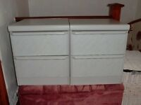 2 grey bedside lockers, and one larger set of draws grey