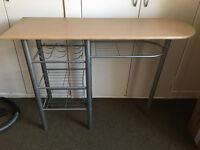 Kitchen unit with wine holder