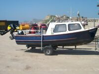 Fishing boat. 16 ft Oyster Catcher with Mercury 15 horse power outboard for sale.