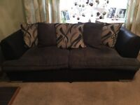 Two 3 seater sofas, with spare cushion cases