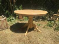 Round wooden table and four chairs.
