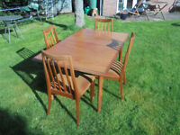 Dining table and four chairs with extension leaf. Free for collection