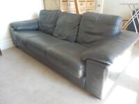 Two grey leather 3 seater sofas - will sell separately.
