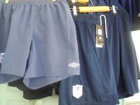 10 pairs of new football shorts in large an extra large