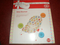 Baby bouncer, changing mat, Mothercare bath...