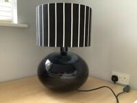 Large black table lamp with black and white shade
