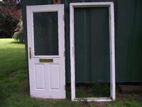 Half glazed wood effect white external upvc door and frame.