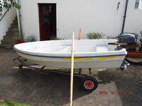 As New Tehri fishing dinghy/Tender with launching trolley and 4 hp outboard.