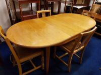 Extending light wood Dining Table and 4 Chairs