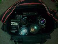Minolta camera - lenses, flash, filters, instructions and bag