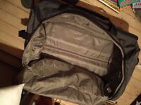 Large Holdall Style Suitase with concealed Handle and Wheels - Very Tough - Hardly Used