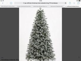 7ft Icelandic king artificial Christmas tree with snow and pine cones.