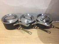 Three Circulon saucepans
