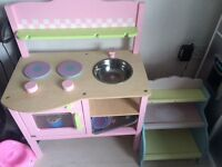 Wooden pink kitchen and cake stand