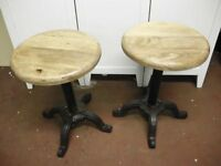 2 MATCHING CAST IRON AND STEEL PUB TABLE STOOLS