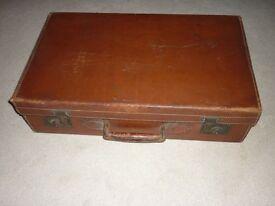 Vintage large rigid leather suitcase brown