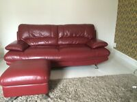 Red leather 3 seater 2 seater and foot stool