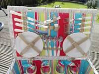 White washed wicker picnic basket