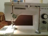 Vintage New Home triple zigzag sewing machine model 888