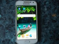 Samsung s5 Mini in good working order, with battery charger.