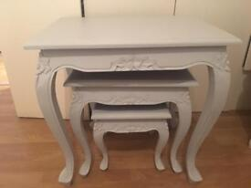 Nest of three grey side tables