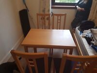 Extendable Dining room table and chairs.