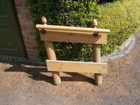Wooden handrail for garden steps