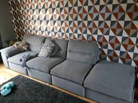 Large grey sofa and pouffr