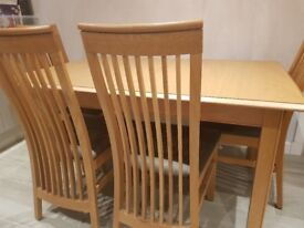 Solid Oak Extending Dining Table (1.45m to 1.95m x 0.95m wide x 0.75m high) with 5 chairs .